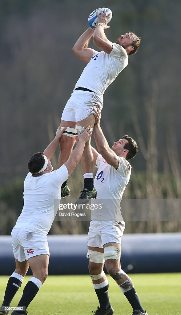 Chris Robshaw catches the ball supported by Jamie George (L) and Josh Beaumont during the England training session held at Pennyhill Park on February 12, 2016 in Bagshot, England.
