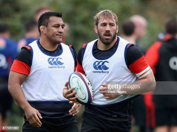 Chris Robshaw looks on with team mate Mako Vunipola during the England training session held at Pennyhill Park on November 21 2017 in Bagshot England