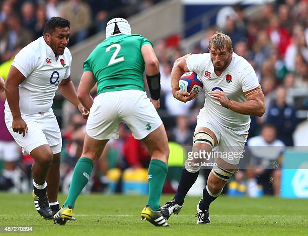 Chris Robshaw of England is challenged by Rory Best of Ireland during the QBE International match between England and Ireland at Twickenham Stadium...