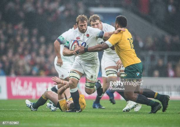 Chris Robshaw of England is tackled by Samu Kerevi of Australia during the Old Mutual Wealth Series autumn international match between England and...