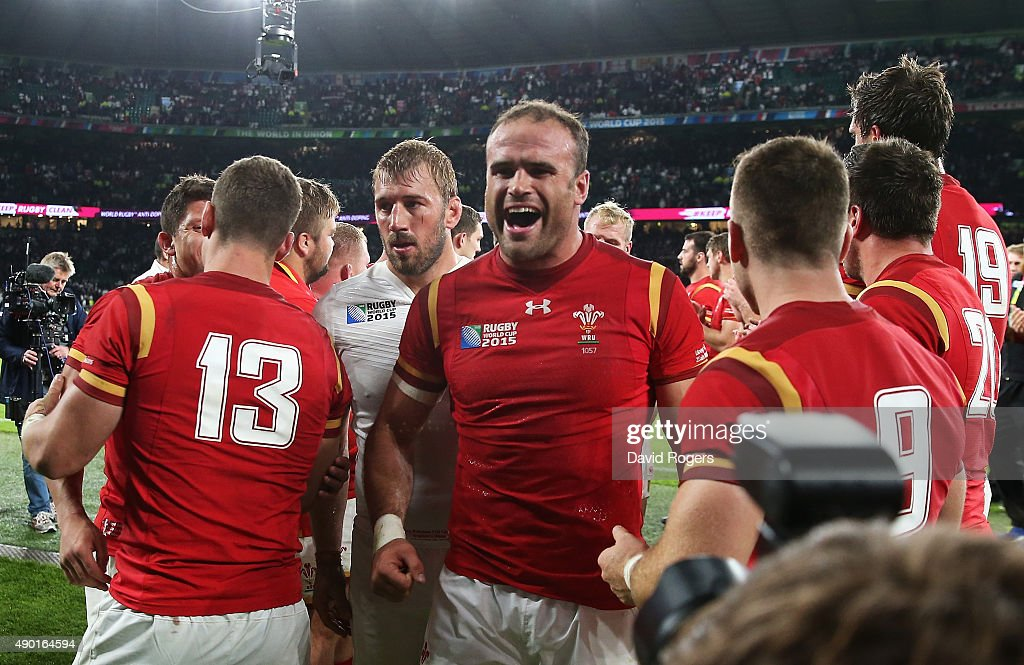 Chris Robshaw of England leaves the field dejected as Jamie Roberts of Wales celebrates after the 2015 Rugby World Cup Pool A match between England...