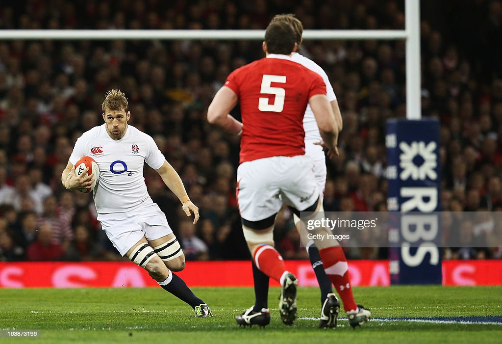 <a gi-track='captionPersonalityLinkClicked' href=/galleries/search?phrase=Chris+Robshaw&family=editorial&specificpeople=2375303 ng-click='$event.stopPropagation()'>Chris Robshaw</a> of England makes a break during the RBS Six Nations match between Wales and England at Millennium Stadium on March 16, 2013 in Cardiff, Wales.