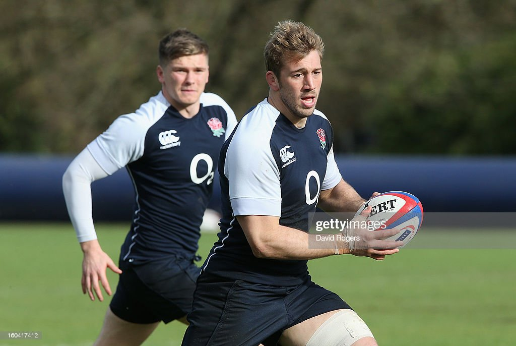 Chris Robshaw of England runs through a drill with Owen Farrell (L) during an England training session at Pennyhill Park on January 31, 2013 in Bagshot, England.