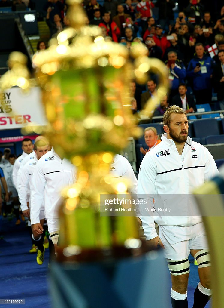 Chris Robshaw of England (R) walks past the Webb Ellis trophy during the 2015 Rugby World Cup Pool A match between England and Uruguay at Manchester City Stadium on October 10, 2015 in Manchester, United Kingdom.