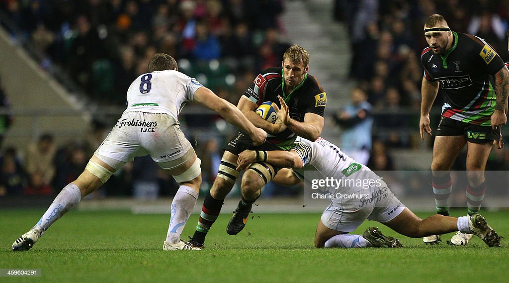 <a gi-track='captionPersonalityLinkClicked' href=/galleries/search?phrase=Chris+Robshaw&family=editorial&specificpeople=2375303 ng-click='$event.stopPropagation()'>Chris Robshaw</a> of Harlequins is tackled by Exeter's Ben Moon during the Aviva Premiership match between Harlequins and Exeter Chiefs at Twickenham Stadium on December 28, 2013 in London, England.