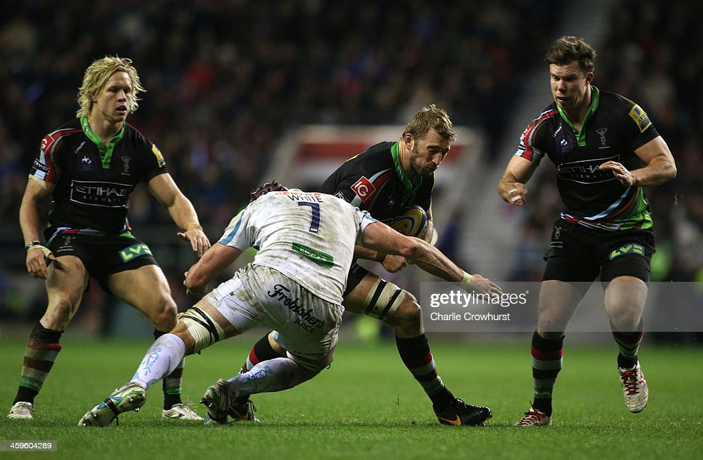 <a gi-track='captionPersonalityLinkClicked' href=/galleries/search?phrase=Chris+Robshaw&family=editorial&specificpeople=2375303 ng-click='$event.stopPropagation()'>Chris Robshaw</a> of Harlequins is tackled by Exeter's Ben White during the Aviva Premiership match between Harlequins and Exeter Chiefs at Twickenham Stadium on December 28, 2013 in London, England.