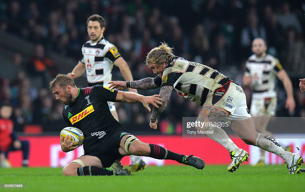 Chris Robshaw of Harlequins is tackled by Richard Hibbard of Gloucester during the Aviva Premiership 'Big Game 8' match between Harlequins and...