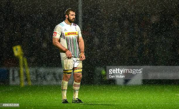 Chris Robshaw of Harlequins looks on as the rain falls during the Aviva Premiership match between Exeter Chiefs and Harlequins at Sandy Park on...