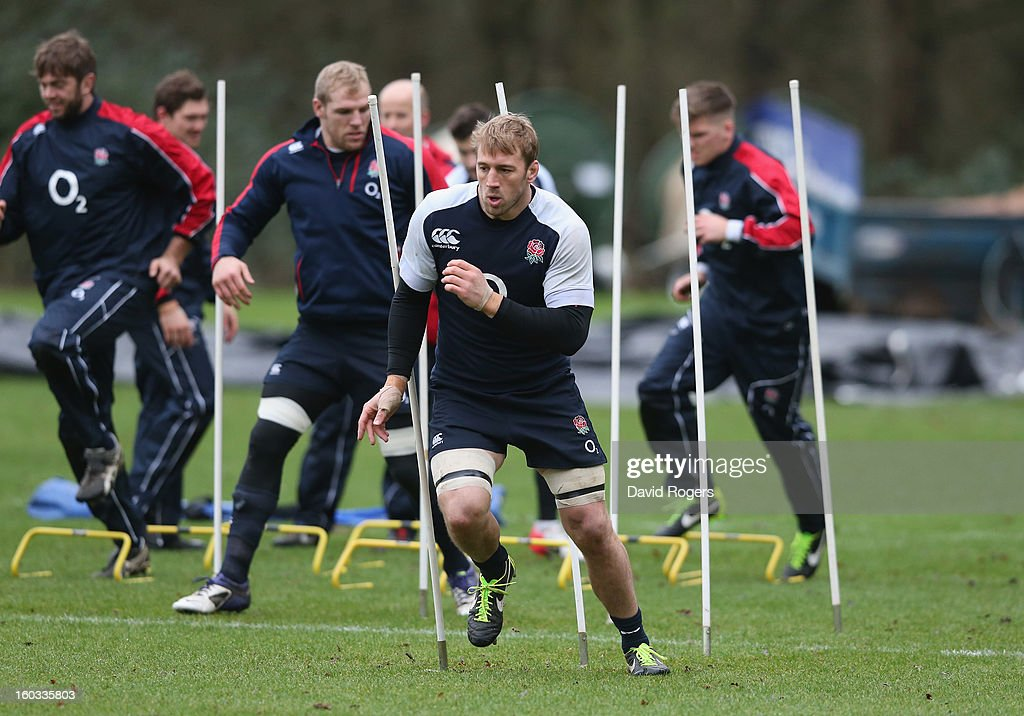 <a gi-track='captionPersonalityLinkClicked' href=/galleries/search?phrase=Chris+Robshaw&family=editorial&specificpeople=2375303 ng-click='$event.stopPropagation()'>Chris Robshaw</a> runs between the slalom poles during the England training session at Pennyhill Park on January 29, 2013 in Bagshot, England.