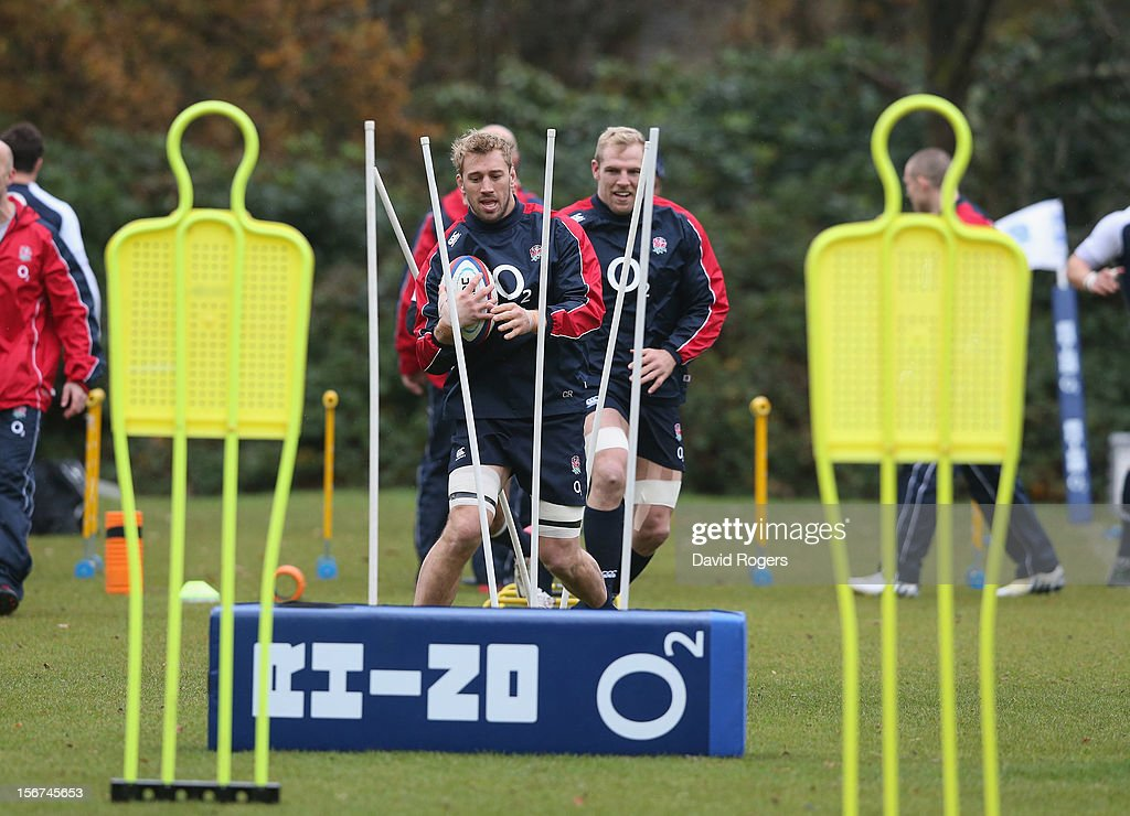<a gi-track='captionPersonalityLinkClicked' href=/galleries/search?phrase=Chris+Robshaw&family=editorial&specificpeople=2375303 ng-click='$event.stopPropagation()'>Chris Robshaw</a> runs with the ball during the England training session held at Pennyhill Park on November 20, 2012 in Bagshot, England.