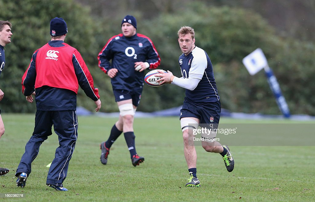 <a gi-track='captionPersonalityLinkClicked' href=/galleries/search?phrase=Chris+Robshaw&family=editorial&specificpeople=2375303 ng-click='$event.stopPropagation()'>Chris Robshaw</a> runs with the ball during the England training session held at Pennyhill Park on January 28, 2013 in Bagshot, England.