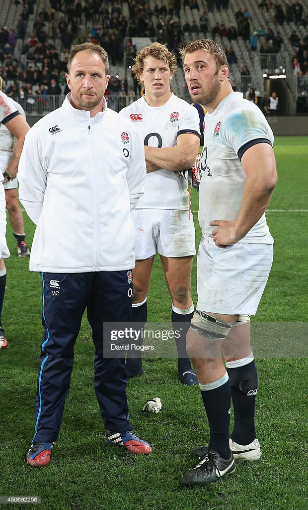 Chris Robshaw, (R) the England captain, assistant coach Mike Catt and Billy Twelvetrees (C) look dejected after their teams defeat during the International Test Match between the New Zealand All Blacks and England at Forsyth Barr Stadium on June 14, 2014 in Dunedin, New Zealand.