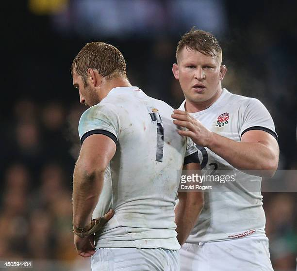 Chris Robshaw the England captain is commiserated by team mate Dylan Hartley after their defeat during the International Test Match between the New...