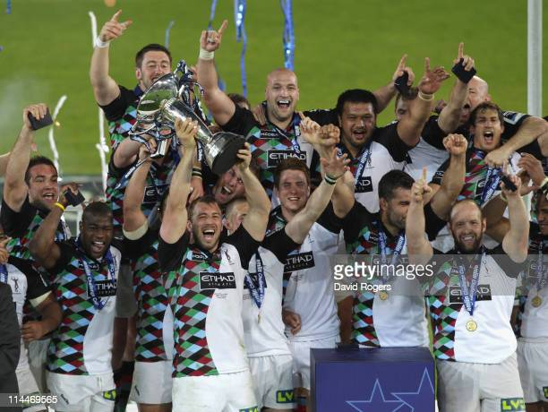 Chris Robshaw the Harlequins captain raises the trophy after their victory during the Amlin Cup final between Harlequins and Stade Francais at the...