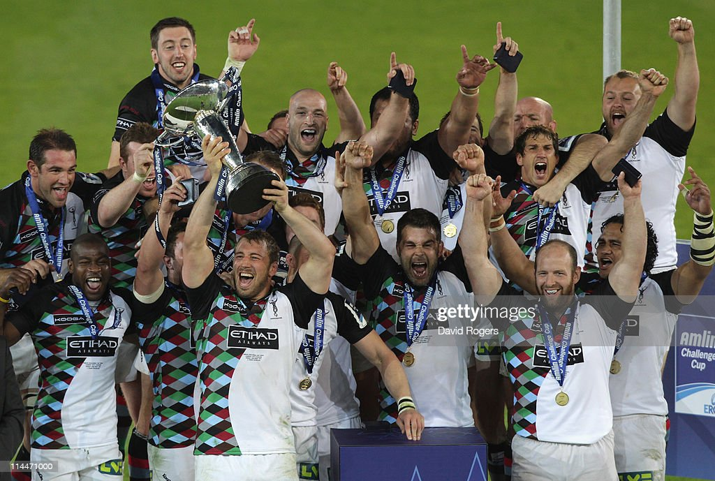 Chris Robshaw the Harlequins captain raises the trophy as Harlequins celebrate after their victory during the Amlin Cup final between Harlequins and...
