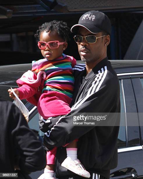 Chris Rock and a young girl are seen in a car park in the SOHO neighborhood on April 24 2010 in New York City