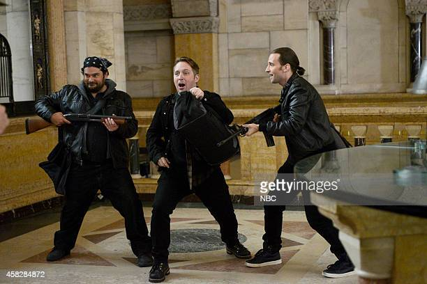 LIVE 'Chris Rock' Episode 1667 Pictured Bobby Moynihan Beck Bennett and Kyle Mooney during the 'Bank Robbers' skit on November 1 2014