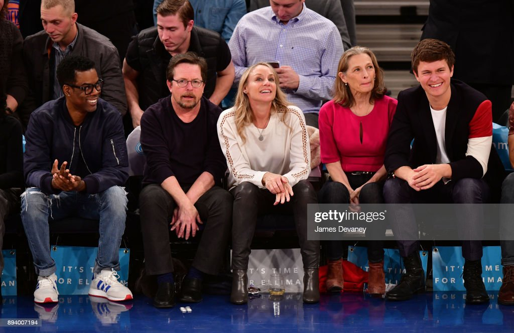 Chris Rock, Michael J. Fox, Tracy Pollan, Grethe Holby and Ansel Elgort attend the Oklahoma City Thunder Vs New York Knicks game at Madison Square Garden on December 16, 2017 in New York City.