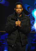 Chris Rock performs on stage at Comedy Central's 'Night of Too Many Stars America Comes Together For Autism Programs' on February 28 2015 in New York...