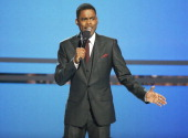 Chris Rock speaks onstage during the 'BET AWARDS' 14 held at Nokia Theater LA LIVE on June 29 2014 in Los Angeles California