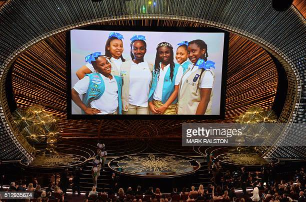 Chris Rock's daughters and Girl Scouts troop are seen on a screen on stage at the 88th Oscars on February 28 2016 in Hollywood California AFP PHOTO /...