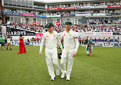 Chris Rogers and Michael Clarke of Australia walk onto the ground during their final test match during day four of the 5th Investec Ashes Test match...