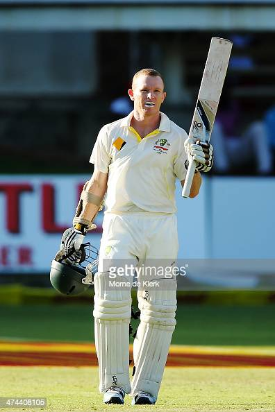 Chris Rogers of Australia celebrates getting 100 runs during day four of the Second Test match between South Africa and Australia at AXXESS St...