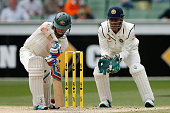 Chris Rogers of Australia gets an inside edge that goes onto the stumps as MS Dhoni of India looks on during day four of the Third Test match between...