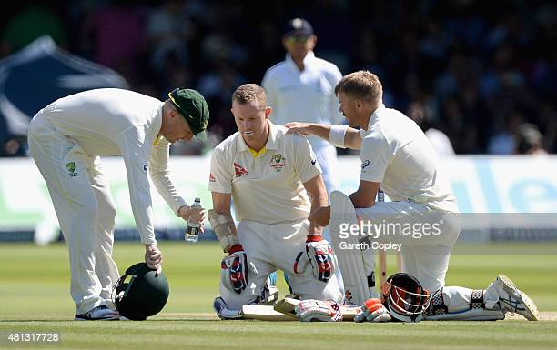 Chris Rogers of Australia is checked on by Brad Haddin and David Warner after stopping injuried during day four of the 2nd Investec Ashes Test match...