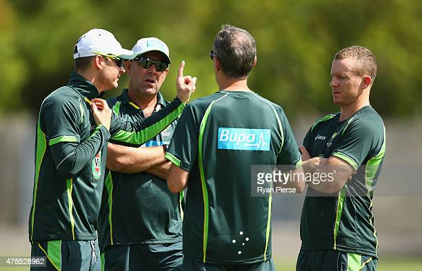 Chris Rogers of Australia is spoken to by Australian Team Doctor Peter Brukner Michael Clarke of Australia and Australian coach Darren Lehmann before...