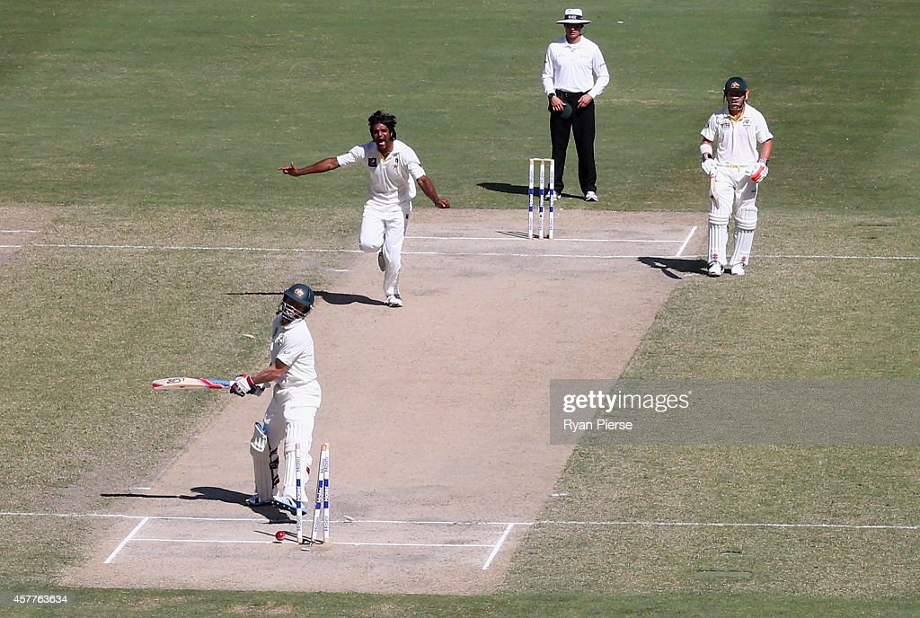 <a gi-track='captionPersonalityLinkClicked' href=/galleries/search?phrase=Chris+Rogers+-+Cricket+Player&family=editorial&specificpeople=178255 ng-click='$event.stopPropagation()'>Chris Rogers</a> of Australia looks dejected after being bowled by <a gi-track='captionPersonalityLinkClicked' href=/galleries/search?phrase=Rahat+Ali&family=editorial&specificpeople=9407619 ng-click='$event.stopPropagation()'>Rahat Ali</a> of Pakistan during Day Three of the First Test between Pakistan and Australia at Dubai International Stadium on October 24, 2014 in Dubai, United Arab Emirates.