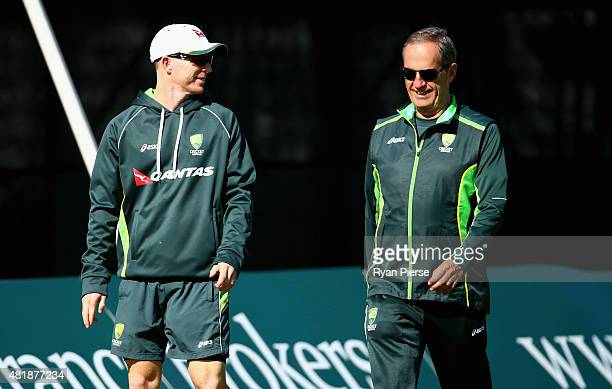 Chris Rogers of Australia speaks to Australian Team Doctor Peter Brukner during day three of the Tour Match between Derbyshire and Australia at The...