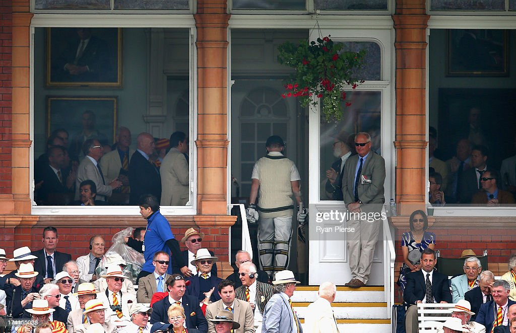 Chris Rogers of Australia walks back into the pavilion after being dismissed by Graeme Swann of England during day four of the 2nd Investec Ashes...