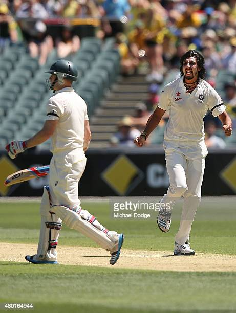 Chris Rogers of Australia walks off as Ishant Sharma of India celebrates his dismissal during day one of the First Test match between Australia and...