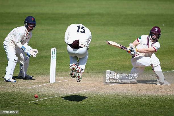 Chris Rogers of Somerset sweeps as Steven Croft of Lancashire takes evasive action off the boiwling of Simon Kerrigan during day four of the...