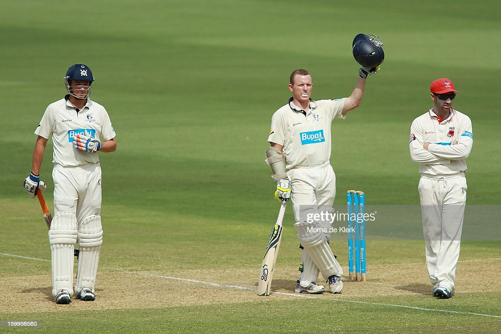<a gi-track='captionPersonalityLinkClicked' href=/galleries/search?phrase=Chris+Rogers+-+Cricket+Player&family=editorial&specificpeople=178255 ng-click='$event.stopPropagation()'>Chris Rogers</a> (C) of the Bushrangers calls for a new helmet after he was hit by a delivery from Joe Mennie of the Redbacks during day one of the Sheffield Shield match between the South Australia Redbacks and the Victoria Bushrangers at Adelaide Oval on January 24, 2013 in Adelaide, Australia.