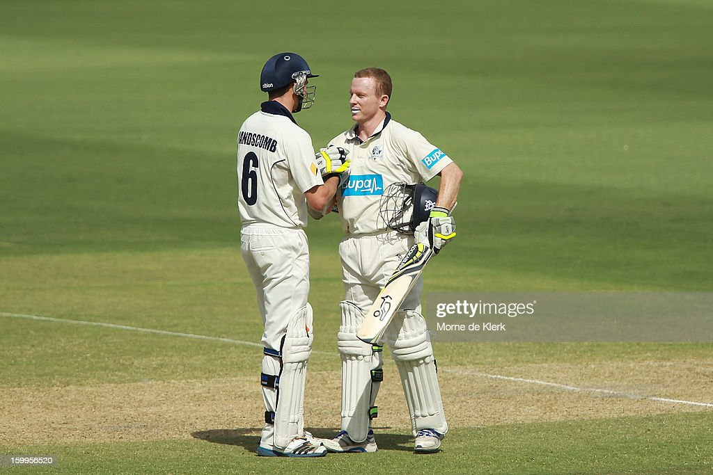 <a gi-track='captionPersonalityLinkClicked' href=/galleries/search?phrase=Chris+Rogers+-+Cricket+Player&family=editorial&specificpeople=178255 ng-click='$event.stopPropagation()'>Chris Rogers</a> (R) of the Bushrangers is congratulated by his team mate Peter Handscomb (L) after reaching 100 runs during day one of the Sheffield Shield match between the South Australia Redbacks and the Victoria Bushrangers at Adelaide Oval on January 24, 2013 in Adelaide, Australia.