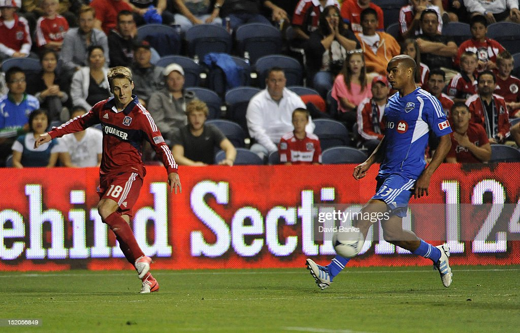 Chris Rolfe #18 of Chicago Fire and Matteo Ferrari #13 of Montreal Impact vie for the ball in an MLS match on September 15, 2012 at Toyota Park in Bridgeview, Illinois. The Chicago Fire defeated the Montreal Impact 3-1.