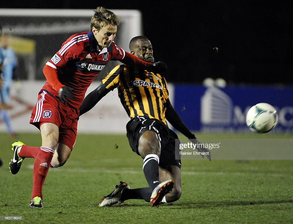 Chris Rolfe #17 of the Chicago Fire and Amadou Sanyang #23 of the Charleston Battery battle for the ball during the first half of a game at Blackbaud Stadium on February 20, 2013 in Charleston, North Carolina.