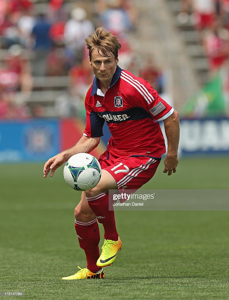 Chris Rolfe #17 of the Chicago Fire chases the ball against Sporting Kansas City during an MLS match at Toyota Park on July 7, 2013 in Bridgeview, Illinois. Sporting Kansas City defeated the Fire 2-1.