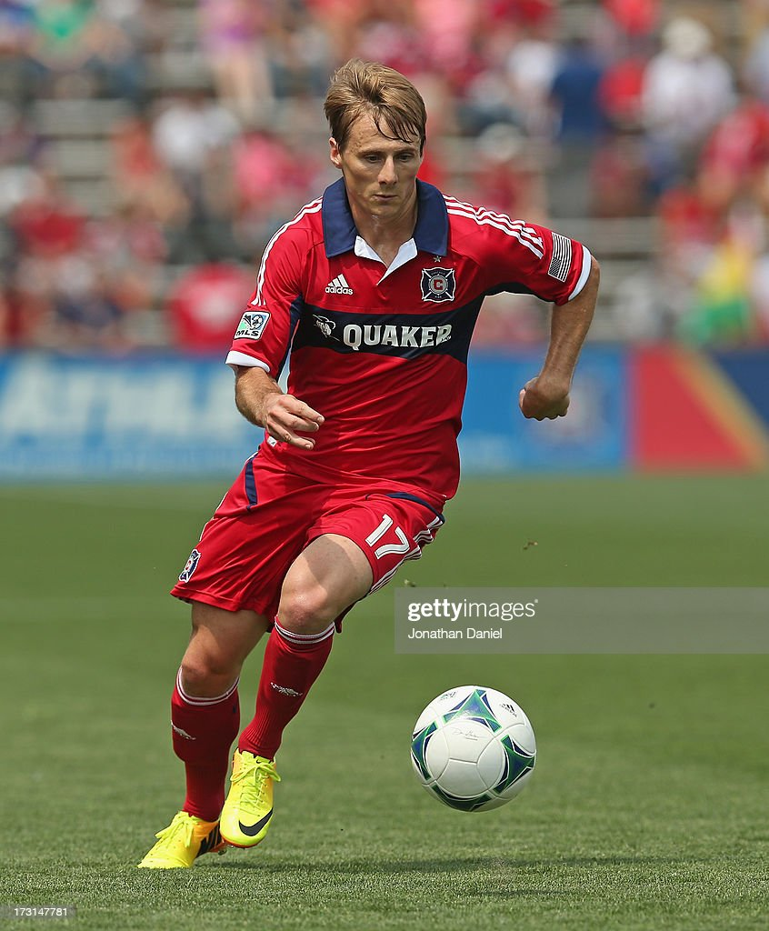 <a gi-track='captionPersonalityLinkClicked' href=/galleries/search?phrase=Chris+Rolfe&family=editorial&specificpeople=887999 ng-click='$event.stopPropagation()'>Chris Rolfe</a> #17 of the Chicago Fire chases the ball against Sporting Kansas City during an MLS match at Toyota Park on July 7, 2013 in Bridgeview, Illinois. Sporting Kansas City defeated the Fire 2-1.