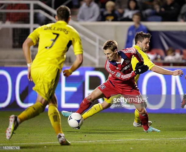 Chris Rolfe of the Chicago Fire moves between Josh Williams of the Columbus Crew and teammate Danny O'Rourke during the first half of their MLS...