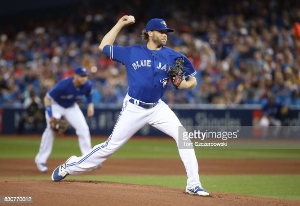 Chris Rowley of the Toronto Blue Jays delivers the first pitch of his MLB career in the first inning during MLB game action against the Pittsburgh...