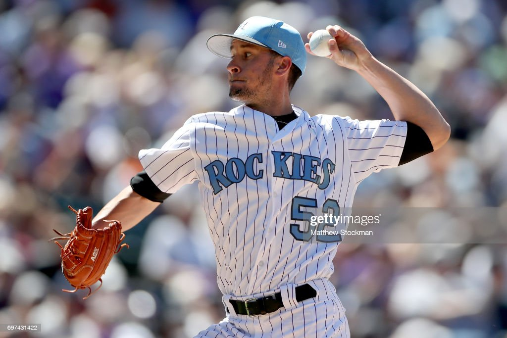 Chris Rusen #52 of the Colorado Rockies throws in the sixth inning against the San Francisco Giants at Coors Field on June 18, 2017 in Denver, Colorado.