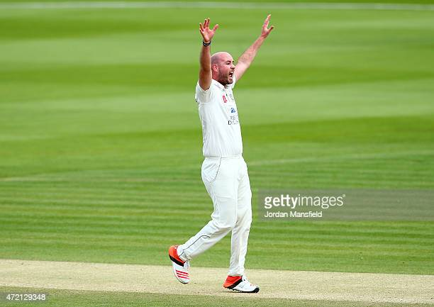 Chris Rushworth of Durham celebrates getting the wicket of Adam Voges of Middlesex during day three of the LV County Championship match between...