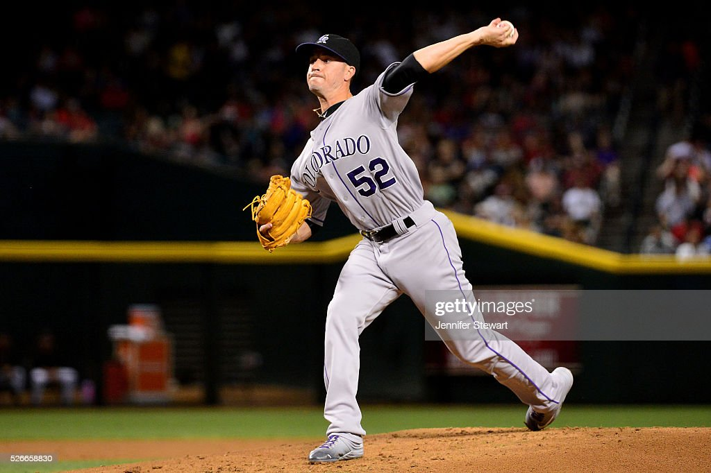 Chris Rusin #52 of the Colorado Rockies delivers a pitch in the first inning against the Arizona Diamondbacks at Chase Field on April 30, 2016 in Phoenix, Arizona.