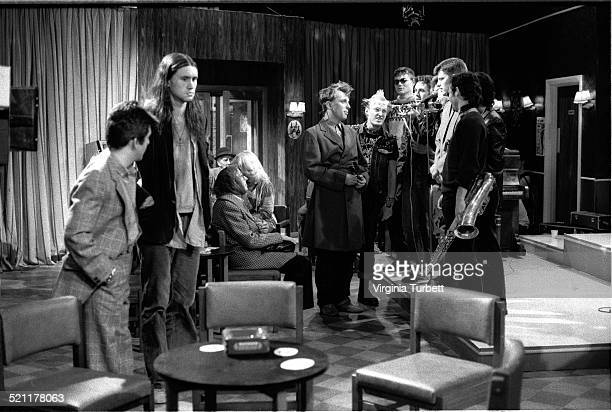 Chris Ryan as Mike and Nigel Planer as Neil with Rik Mayall as Rick and Adrian Edmondson as Vyvyan talking to members of the band Madness on set...