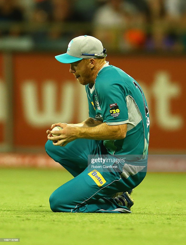 Chris Sabburg of the Heat takes a catch to dismiss Simon Katich of the Scorchers during the Big Bash League final match between the Perth Scorchers and the Brisbane Heat at the WACA on January 19, 2013 in Perth, Australia.