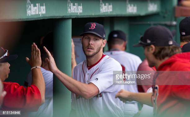 Chris Sale of the Boston Red Sox is congratulated by his teammates in the dugout after the seventh inning of a game against the New York Yankees at...