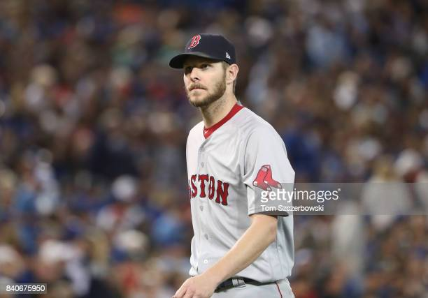 Chris Sale of the Boston Red Sox is walks off the mound after retiring the side in the seventh inning during MLB game action against the Toronto Blue...